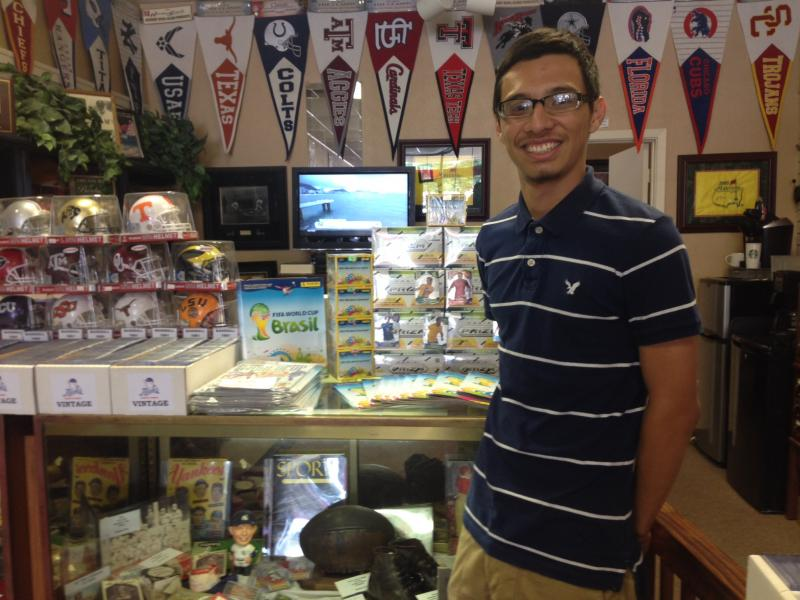 Hugo Salazar, 18, is collecting the Panini America soccer stickers.