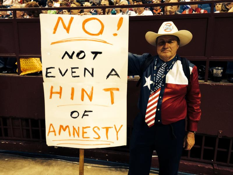 An attendee showed his position on undocumented immigrants.