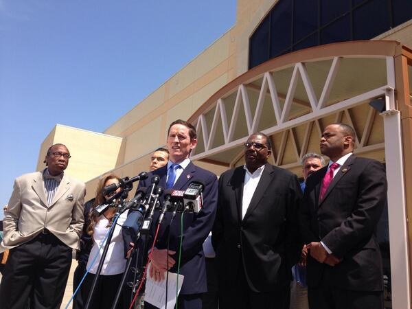 Dallas County Judge Clay Jenkins, center, announced the North Texas sites that will shelter immigrant children.