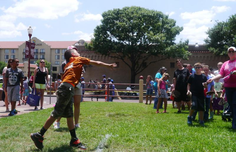 Children compete in the Cow Chip Throwing Contest during National Day of the American Cowboy.