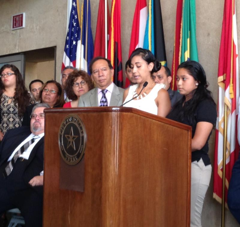 Dallas ISD student Sylvia Marroquin (black shirt) told her story of fleeing El Salvador during a press conference at Dallas City Hall on Monday. An interpretor (to her left) translated her story.