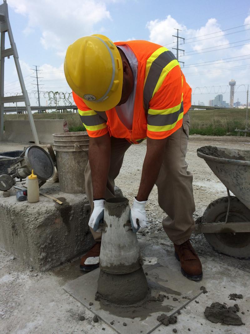 Rep. Veasey testing concrete mixture.