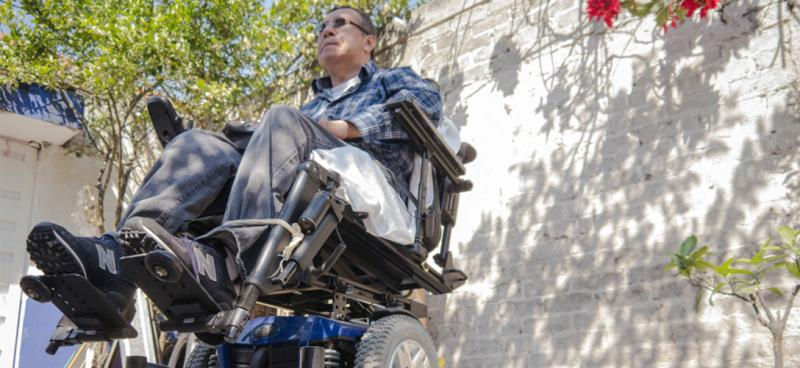 Santiago Arias in front of his Mexico City home. Arias is paralyzed from the chest down after a two-story fall from the roof of a warehouse at a Houston job site in 2006.