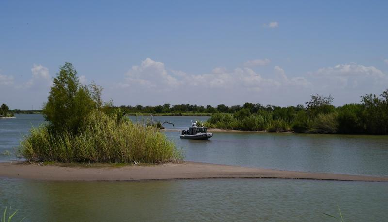 A federal patrol boat monitors the Texas-Mexico border.