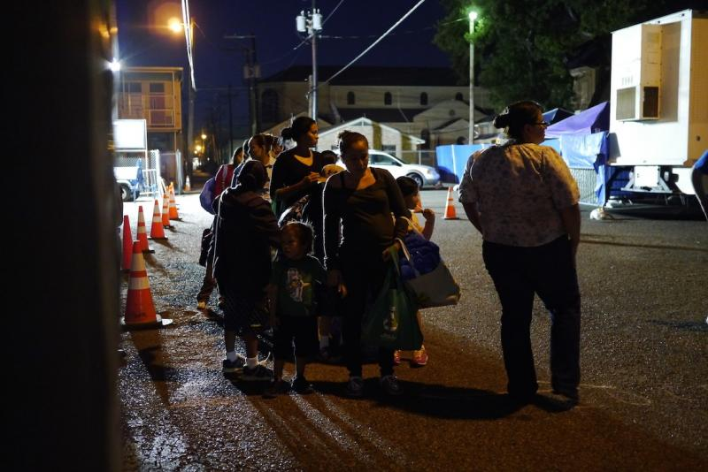 Immigrants get ready for a bus trip out of McAllen to stay temporarily with a sponsored relative in the U.S. There's an unprecendented number of people crossing the border, and many of them are unaccompanied children who need food and shelter.