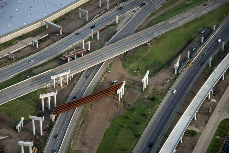 The I-35E/Loop 12 elevated interchange under construction.