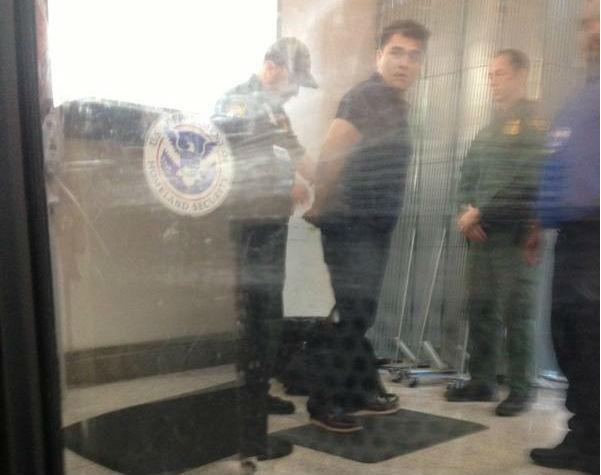 Jose Antonio Vargas in handcuffs at McAllen/Miller International Airport.
