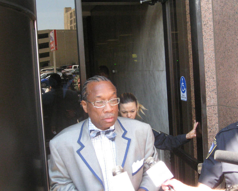 Dallas County Commissioner John Wiley Price, emerging from Dallas' federal courthouse, where he pleaded not guilty to conspiracy, fraud and other charges