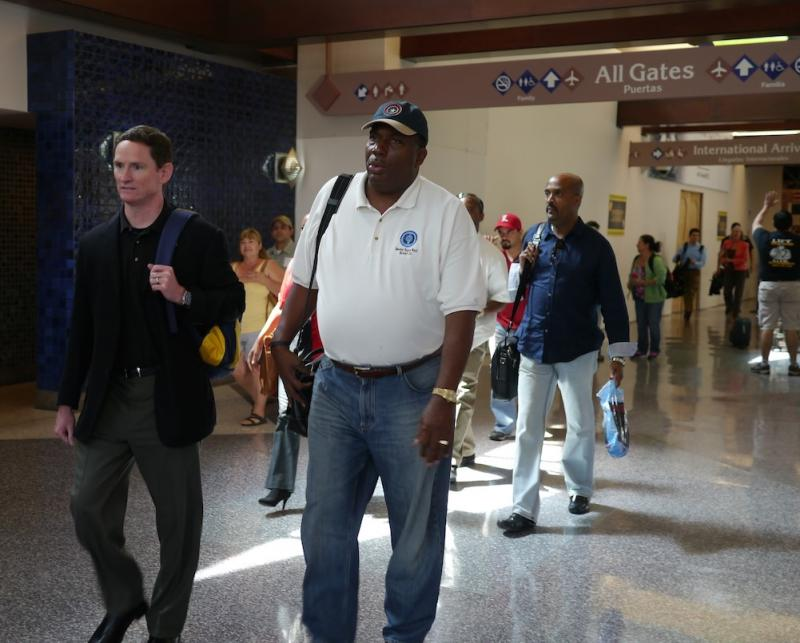 Dallas County Judge Clay Jenkins, on the left, and State Sen. Royce West arrived at the McAllen airport to tour detention facilities for immigrant children, many of whom are from Central America.
