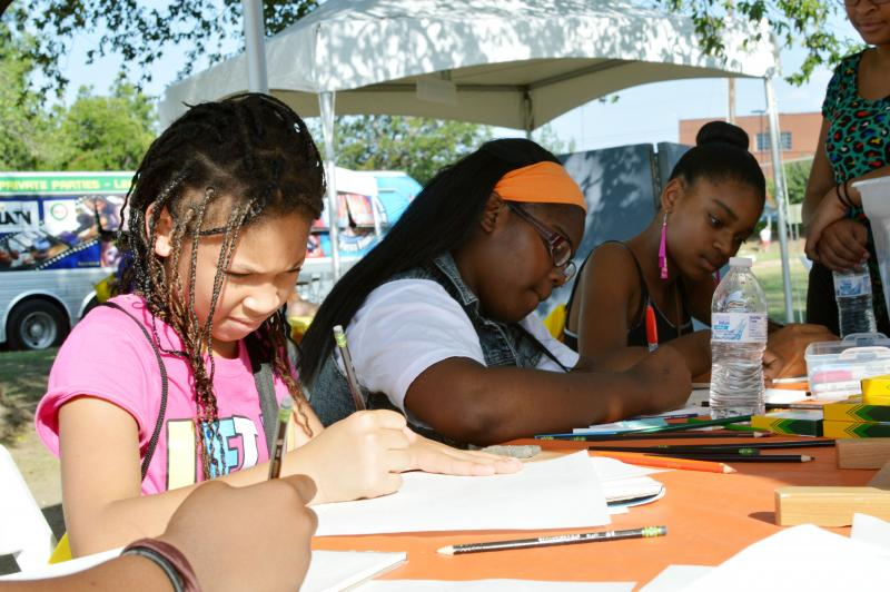 Participants learn how to draw and paint at one of the booths at Saturday's Turn Up! event in Vickery Meadow.