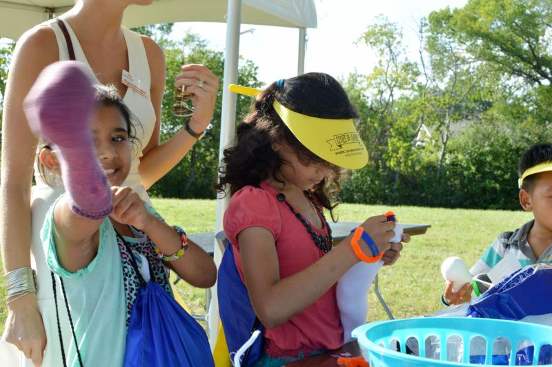 Children make sock puppets at the last Turn Up! event of the summer.