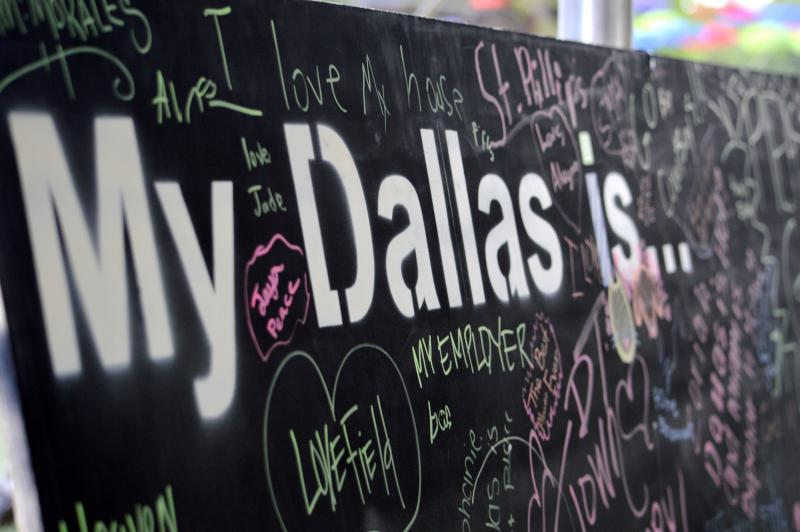 Dallas students and patrons write what Dallas means to them on boards that will be displayed at South Side on Lamar for six weeks.