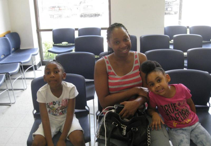 6 year-old Stacie Guice(l), mom Dawn Guice, and 4 year-old Makayla awaiting immunization shots at Dallas County's Health And Human Services clinic
