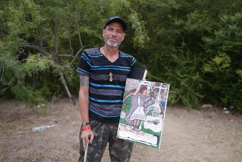 Michael Buffington, 48, is a homeless artist, living in the woods, in Tarrant County.
