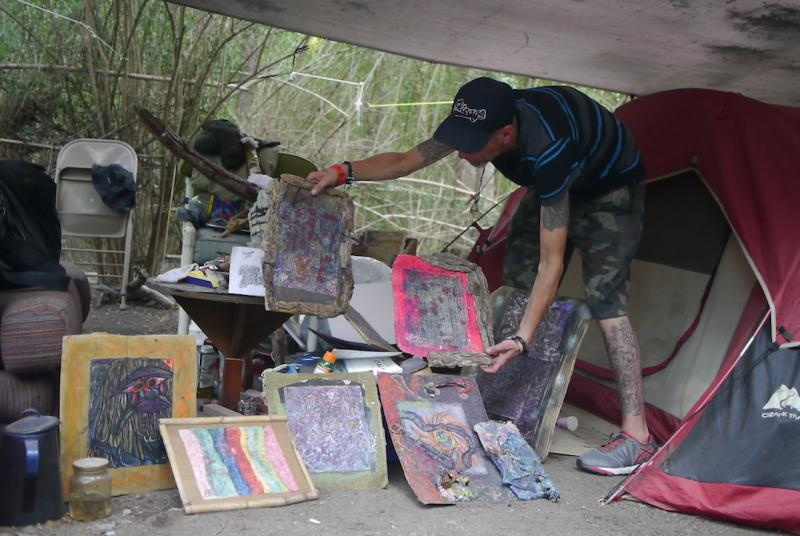 After 12 years in prison, Michael Buffington paints and lives in the woods just miles from downtown Fort Worth.