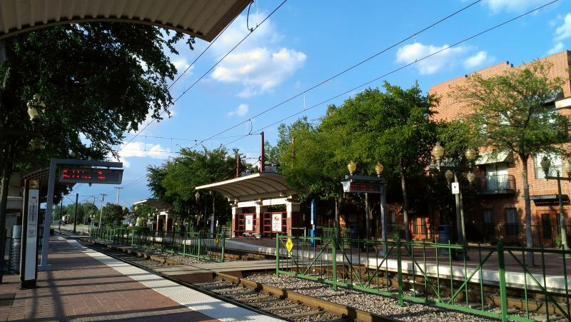 One development that makes Downtown Plano more walkable is its DART train stops.