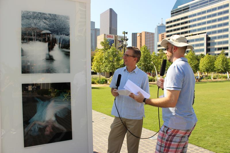 KERA VP of News Rick Holter and 'D' Editor Tim Rogers look at a portrait by Elizabeth Lavin of energy leader Kelcy Warren, who gave the naming gift for Klyde Warren Park.