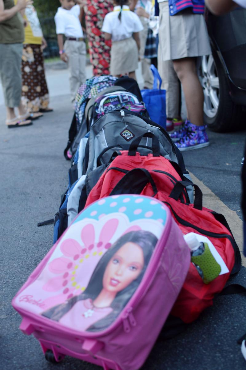 Student backpacks line the parking lot at the Ivy apartments in the Vickery Meadow neighborhood.