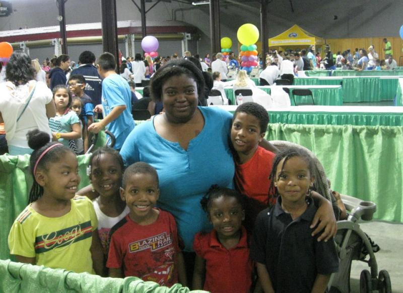 The Jenkins family in line for free vision testing at the 18th annual Dallas back to school fair in Fair Park.