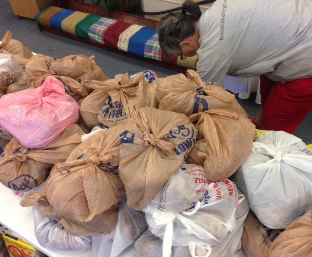 Piles of potatoes are bagged for clients at a Lake Highlands food pantry.