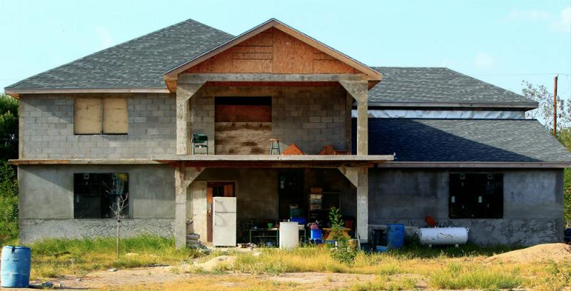 The unfinished home of the Ayala family. The Ayalas can't make ends meet in Texas so they travel to Indiana to pick corn.
