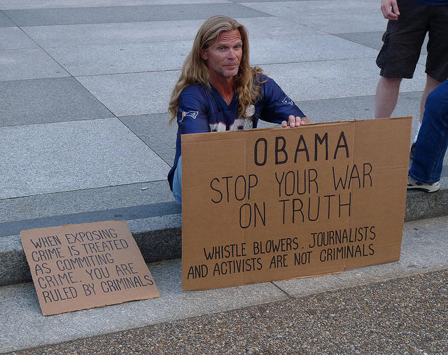 Protestors rally at the White House after Bradley Manning was sentenced for sharing military knowledge with the public and the press.