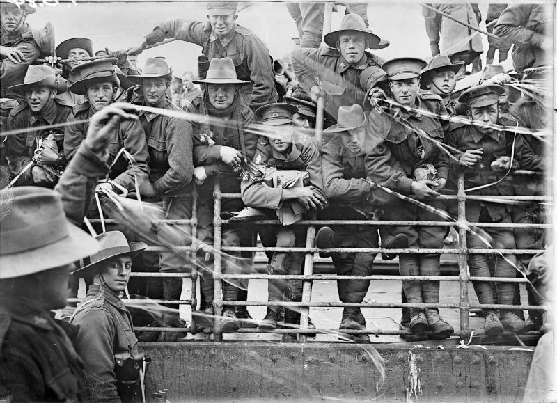 The embarkation of HMAT Ajana in Melbourne, dated July 8, 1916 is a gelatin silver print from an original glass half-plate negative and taken by Josiah Barnes.