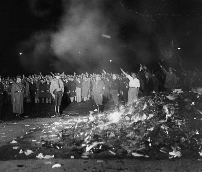 Book burning taking place in Opera Square, Berlin on May 10, 1933.