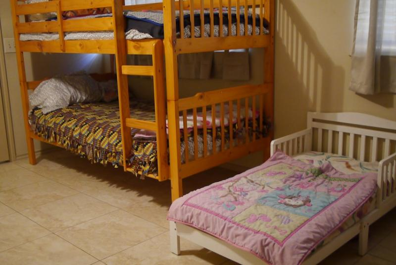 A bedroom for children inside a safe house for domestic violence victims.