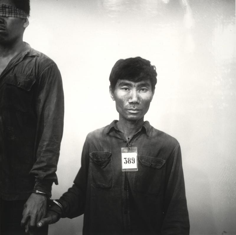 An untitled photograph from 1975 to 1979, by Cambodian Nhem Ein shows prisoner #389 of the Khmer Rouge.