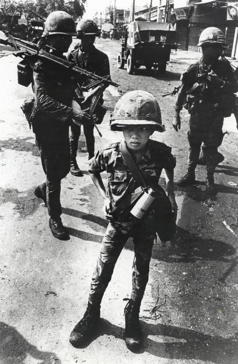 """Little Tiger,"" shown in the photograph from 1968, was rumored to have killed two ""Viet Cong women cadre,"" his mother and teacher in Vietnam."