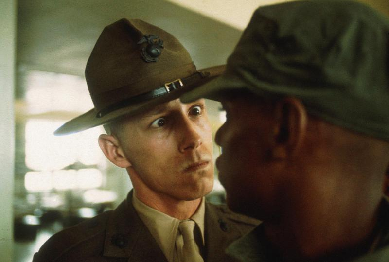 In the photo, a U.S. Marine drill sergeant delivers a severe reprimand to a recruit on Parris Island, South Carolina.