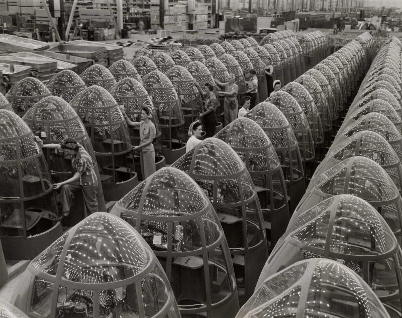 Alfred Palmer's photograph looks a women aircraft workers finishing transparent bomber noses for fighter and reconnaissance planes at the Douglas Aircraft Co. Plant in Long Beach, California in 1942.
