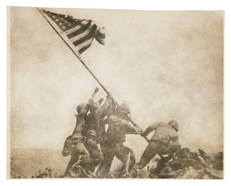 Joe Rosenthal's iconic image <em>Old Glory Goes Up on Mount Suribachi, Iwo Jima</em> from February 23, 1945 is one of <em>WAR/PHOTOGRAPHY</em>'s well-known pieces.
