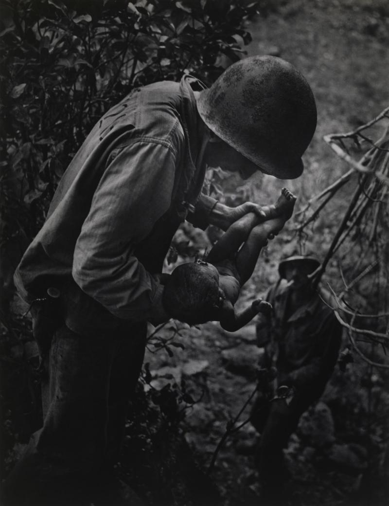 W. Eugene Smith's photograph from June 1944 shows a dying infant found by American soldiers in Saipan.