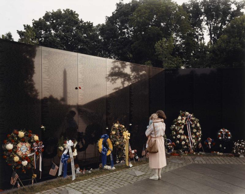 Joel Sternfeld's photo captures the Vietnam Veterans Memorial in Washinton D.C. in May of 1986.