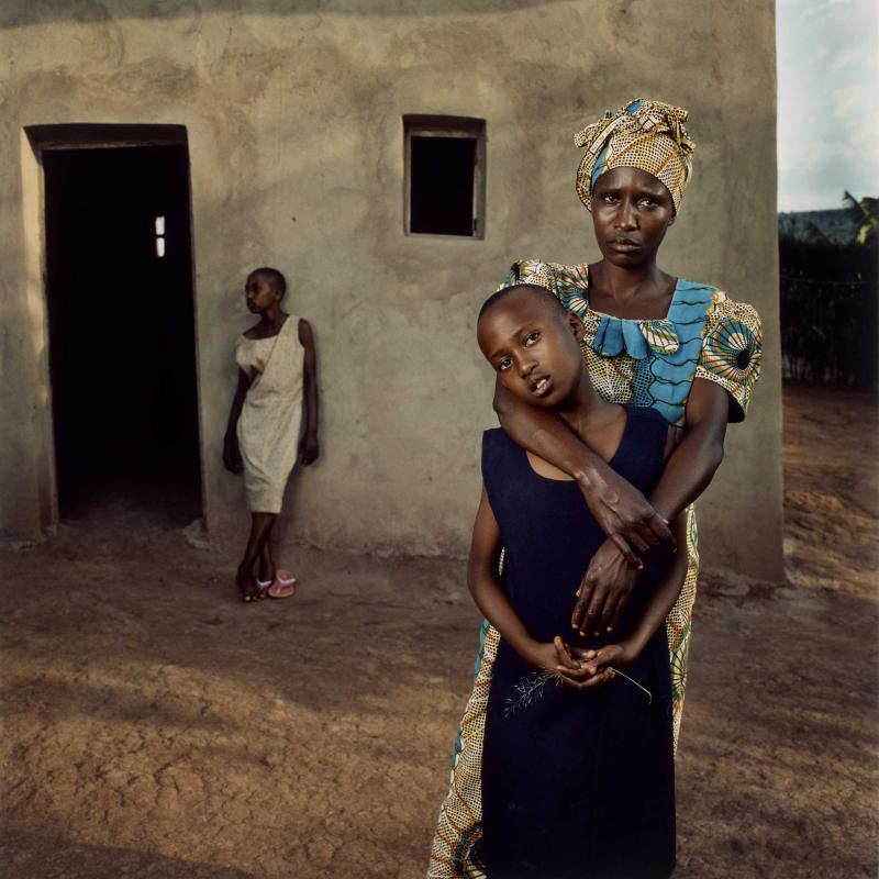 Jonathan C. Torgovnik caught this photo of Valentine with her daughters Amelie and Inez in Rwanda as a part of the series <em>Intended Consequences</em> from 2006.
