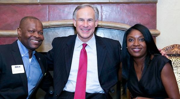 Edward Okpa and Republican Greg Abbott pose with Ronke Okpa, who helped raise funds for Abbott's campaign.