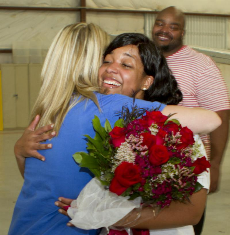 Amber Vinson arrived at Dallas Love Field Tuesday night and was greeted by a colleague from Texas Health Presbyterian Hospital.