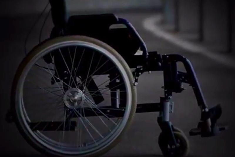 Wendy Davis' latest TV ad opens with a picture of a wheelchair which is used to represent opponent Greg Abbott.