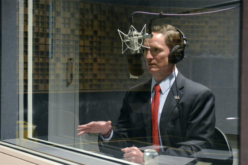 Dallas County Judge Clay Jenkins records a long-distance interview with NPR's Melissa Block for today's All Things Considered in the KERA studios.