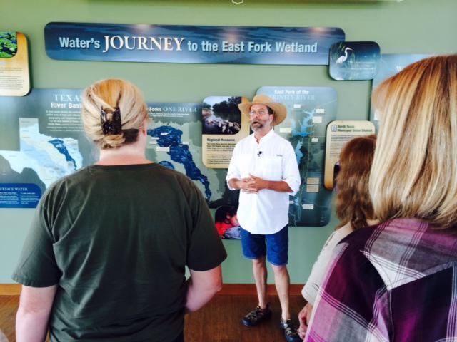 Volunteer Bob Richie explains the wetlands filtering process at the John Bunker Sands Wetland Center.