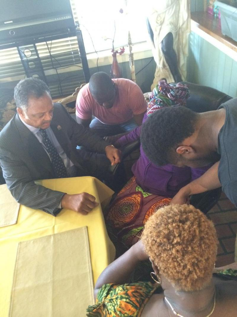 On Tuesday, the Rev. Jesse Jackson Sr. prayed wth Thomas Eric Duncan's mother, sister and nephews.