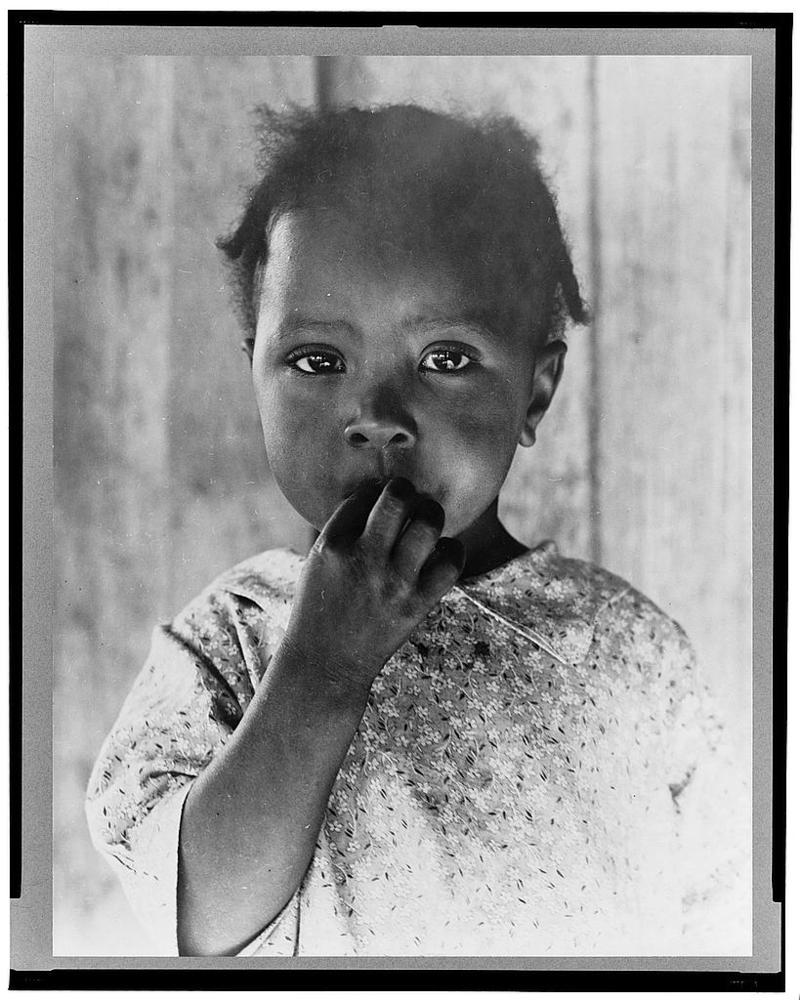 This picture of a child of a day laborer was taken in 1937 in Ellis County.