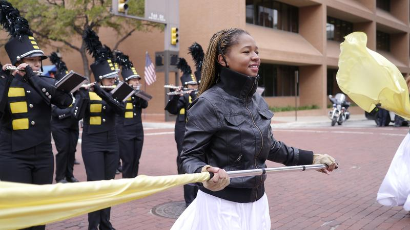 Ebony Washington of Fort Worth's Arlington Heights High School says its been fun but cold to march in the annual Veterans Day Parade in downtown.