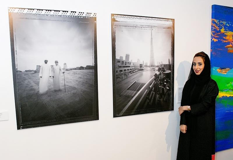 Emirati artist Shamma Al Amri poses next to her pinhole photographs at Fort Worth's Artspace111.