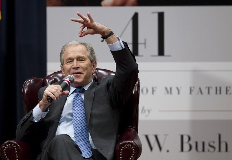 Former President George W. Bush tells a story about his father at Texas A&M University on Tuesday.