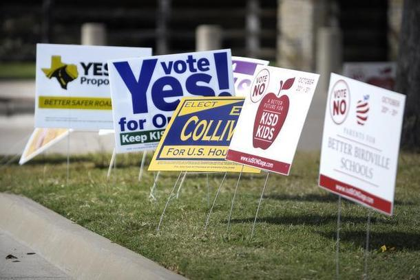 Political signs decorate the lawn near Summerglen Branch Library.