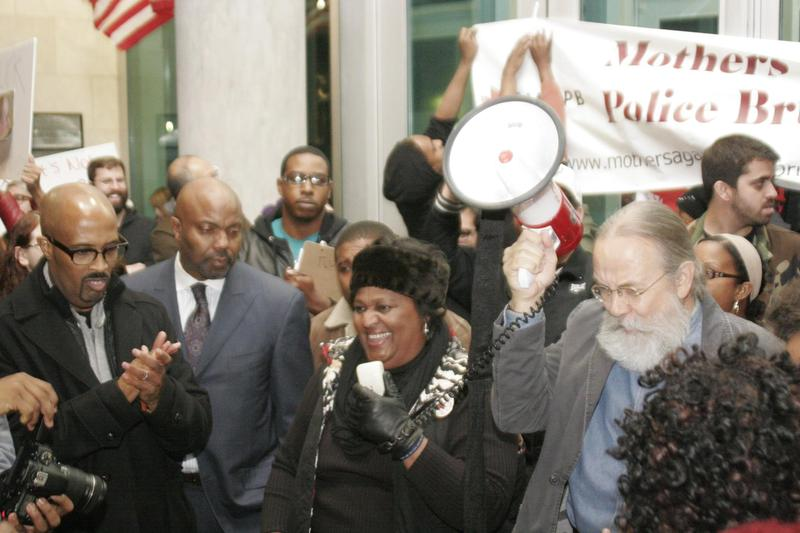 Collette Flanagan, center, lost her son Clinton Allen last year when he was shot and killed by a Dallas police officer.