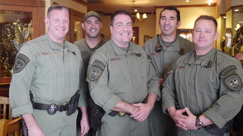 Members of the Fort Worth Police Department's SWAT team pose inside Reata after their free lunch.